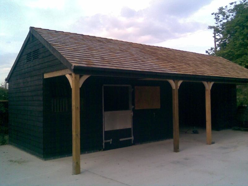 Custom Made Stable Block, Black With Cedar Shingle Tile Roof