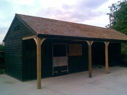 Custom Made Stable Block, Black With Cedar Shingle Tile Roof