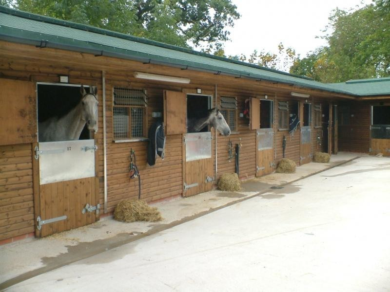 Commercial Stable Block With Green Tile Effect Roof