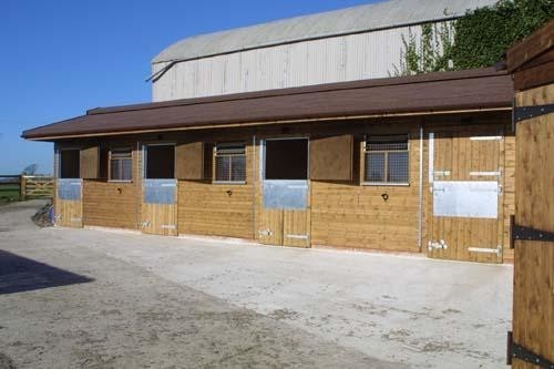 Stabling With Brown Shingle Roof